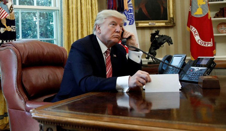 President Trump on the phone in June (Reuters photo: Carlos Barria)
