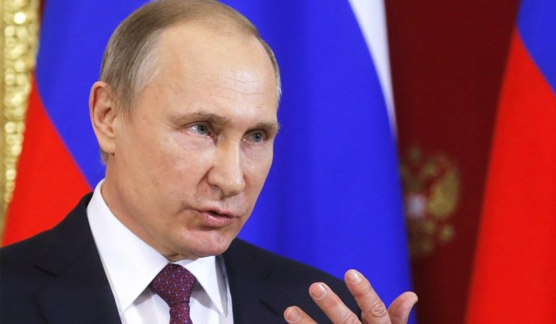 Russian President Vladimir Putin Sergei Ilnitsky Pool Via Reuters