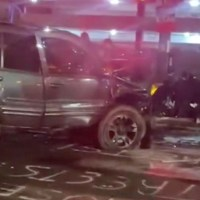Woman Dies after Driver Plows into Crowd Protesting the Police