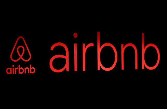 FILE PHOTO: The logos of Airbnb are displayed at an Airbnb event in Tokyo