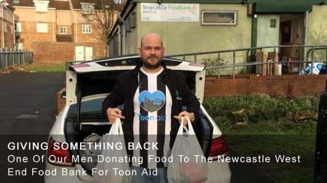 Donating Food To The Newcastle West End Food Bank For Toon Aid