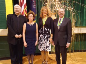 Msgr. Edward O'Connor and Principal Lynn Sabol pose with inductees Sharon Struzinsky Modesto '80 and Atty. Joseph P. Troy '66. Missing from photo is inductee Rev. Stephen L. Maco