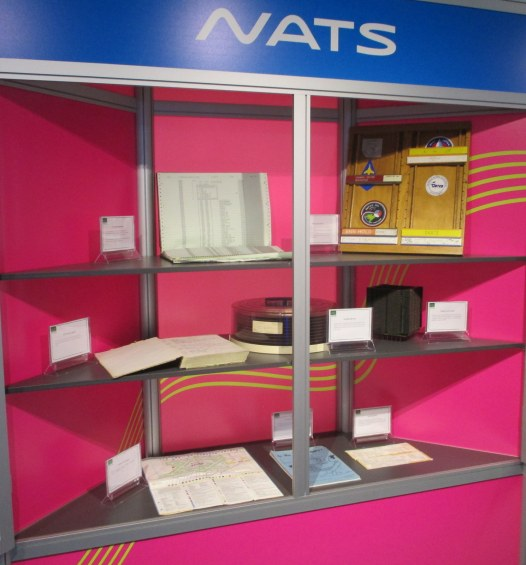 Display of artifacts – log books including the first National Airspace System (NAS) logbook and the final flight strip for Concorde