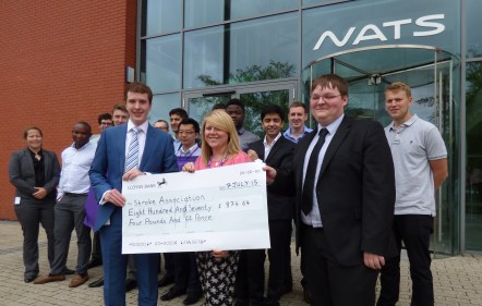 Jonathan Marmont and Lewis Kelly from NATS Early Careers Scheme present a cheque to Lauren Butcher from Stroke Association