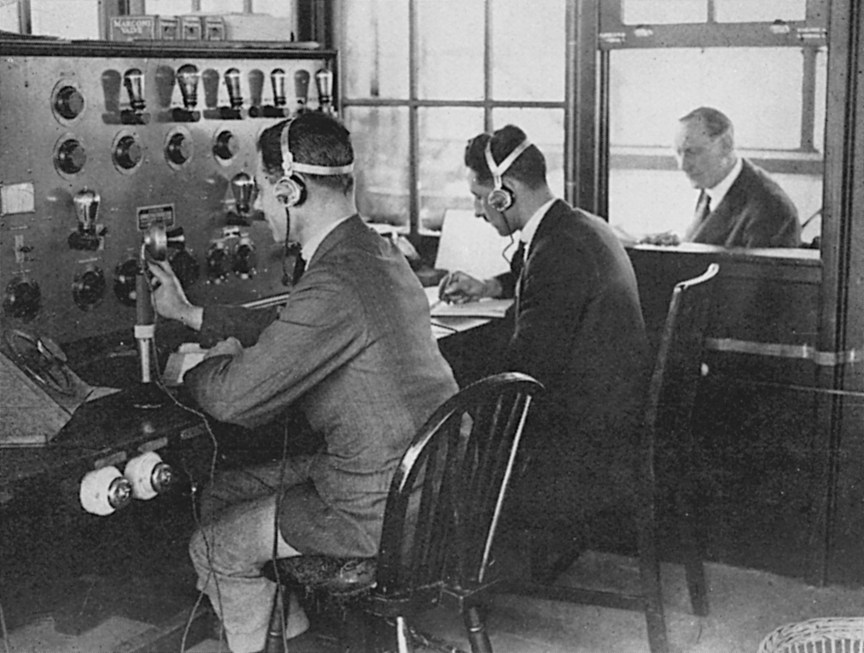 Air Traffic Controllers in the control tower at Croydon Airport are in constant telephonic touch with aeroplanes in flight