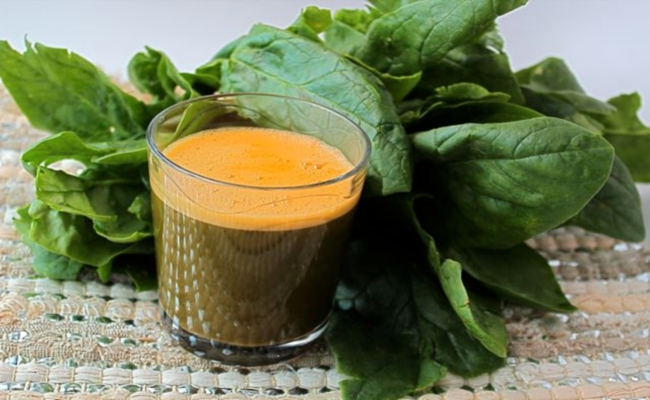 Drinking Carrot and Spinach Juice