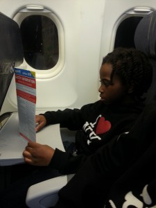 Little Man reading the in flight instructions