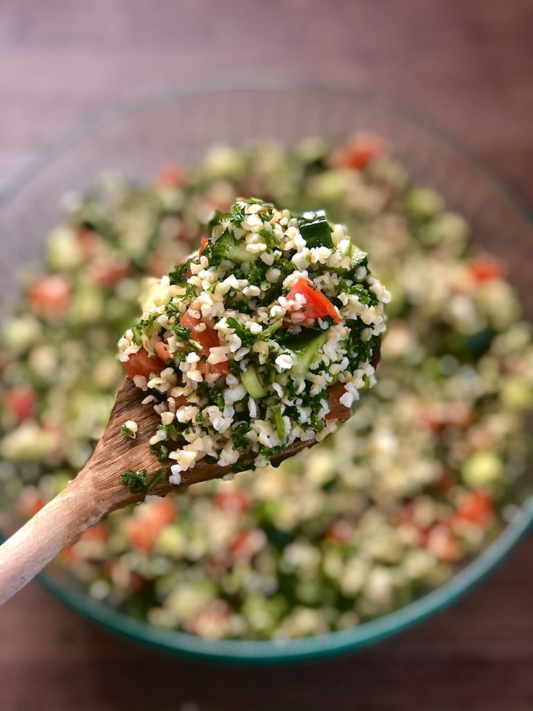 Fresh and filling big batch tabbouleh salad is hearty enough for a vegan main dish, keeps for nearly a week, and is ready in 30 minutes! Recipe at naturalcomfortkitchen.com