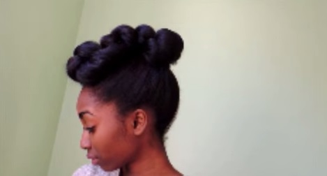 intricate high bun formal hairstyle