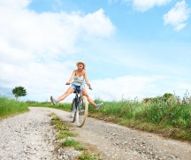 An attractive young woman having fun riding her bicycle