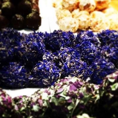 Cornflower coated sea buckthorn pralines