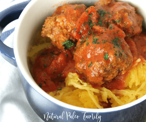 paleo meatballs and sauce on top of spaghetti squash in a bowl