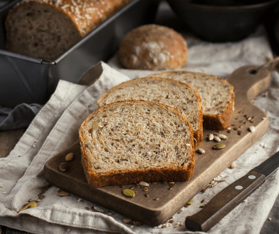 sliced wheat bread on a wooden cutting board