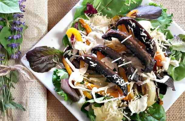 portabella mushroom salad on a square plate