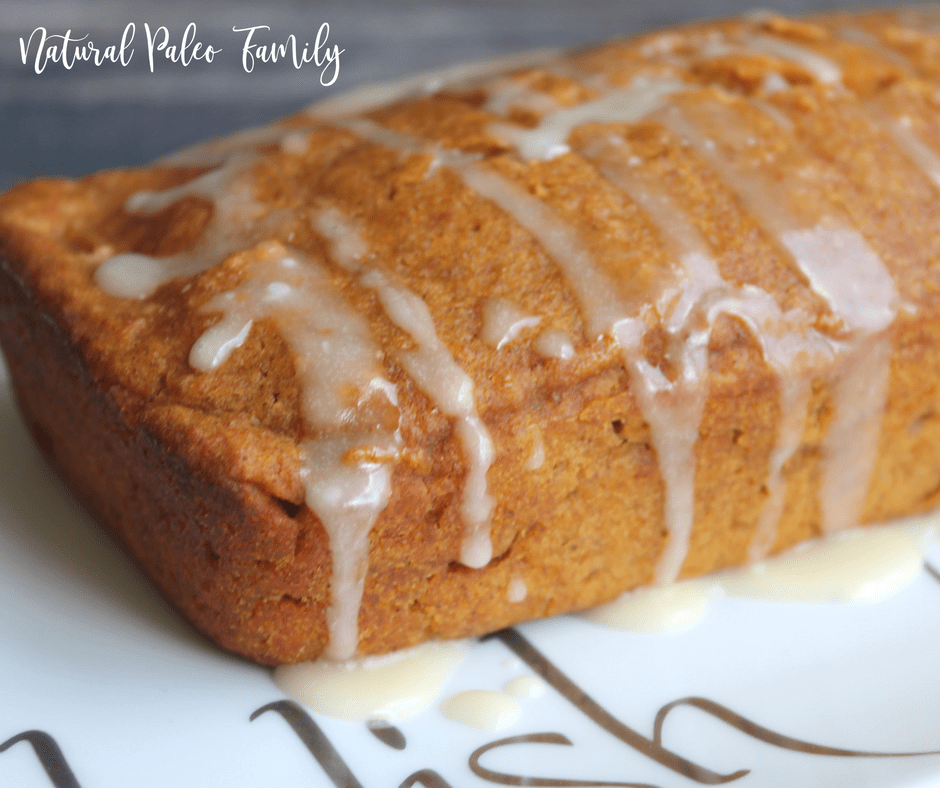 gluten free pumpkin angel food cake with glaze dripping off of the sides