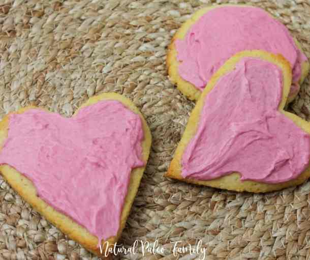 three heart shaped paleo valentine's day cookies on a straw placemat