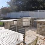 Golden Honey ledger stacked stone veneer outdoor kitchen wall