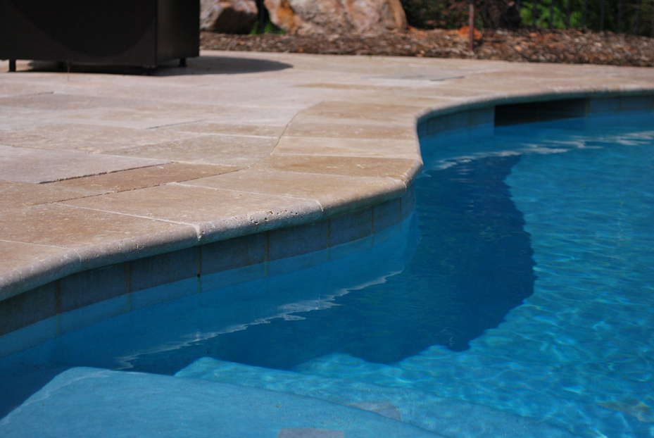 Walnut travertine pavers decking and pool coping