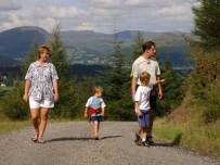 A family walking through the woods at Whinlatter near Keswick