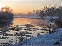 Ice floats downstream on the River Eden
