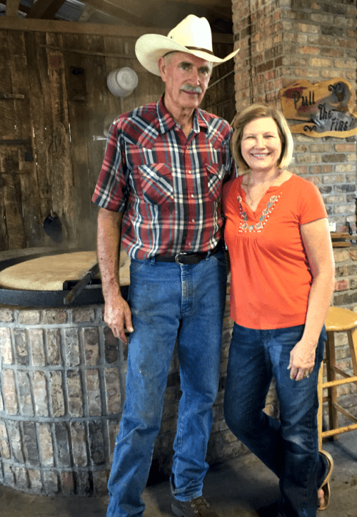 Steve and Sandy Melton at the cane cooking kettle.