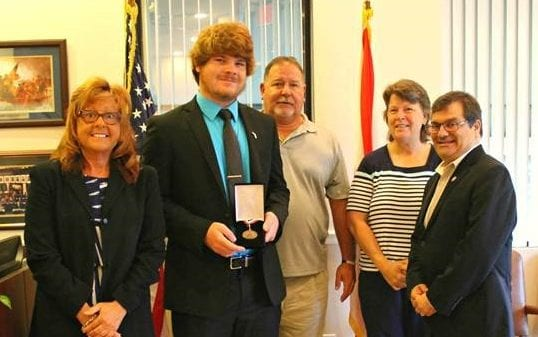 US Rep Gus Bilirakis presents Tanner Smith with Congressional Award Bronze Medal
