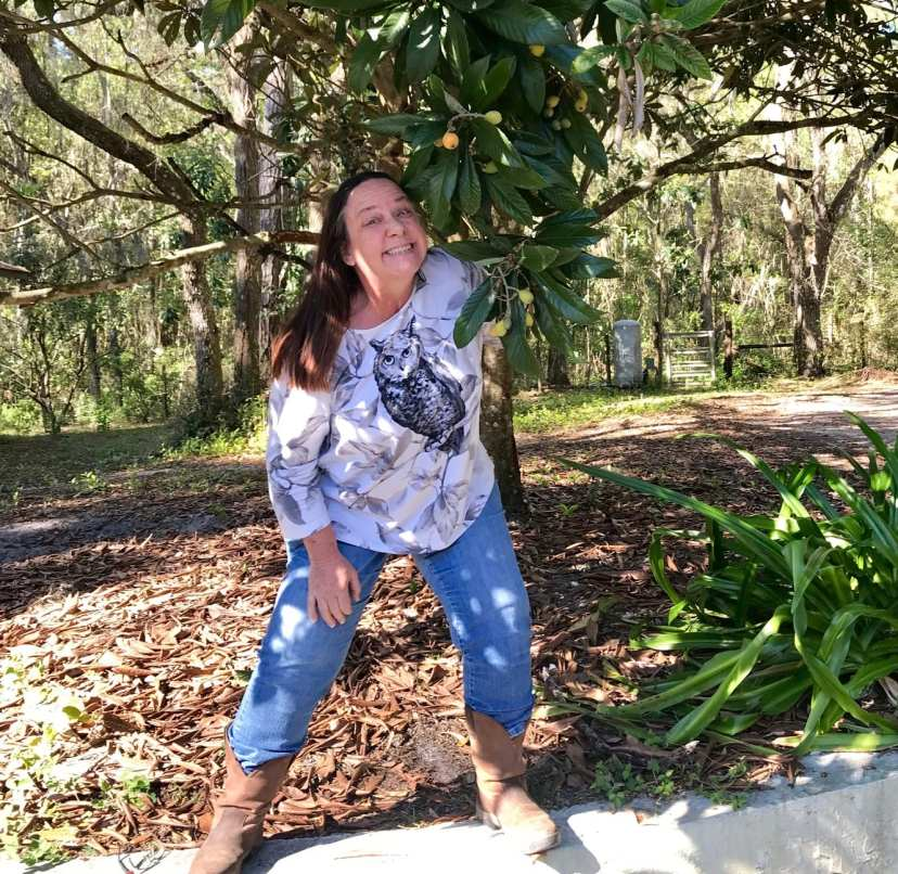 Woman with loquat tree