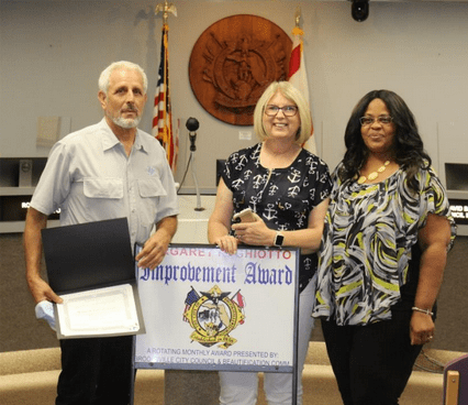 L to R: Michael Burmann, Diana Burmann, Margaret R. Ghiotto Residential Improvement Award winners, Patria Dye, City of Brooksville Beautification Board representative