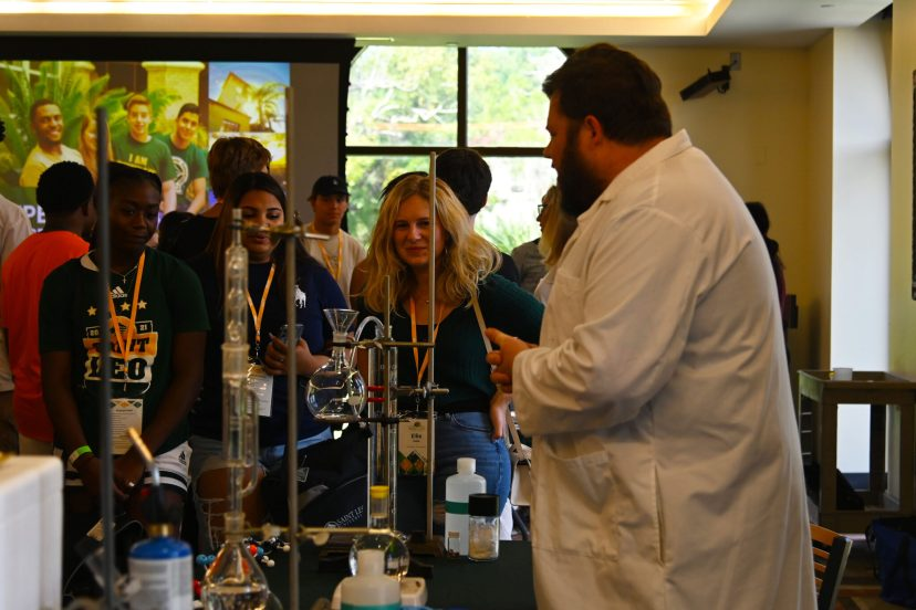 Future Saint Leo University students get a fun look at chemistry from Dr. Patrick Sheridan of the College of Arts and Sciences at the university's Super Saturday event.