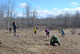 Conservation Volunteers planting trees at Meeting Lake, SK (Photo by Sandra Younie)