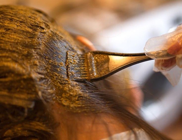 Applying henna on hair