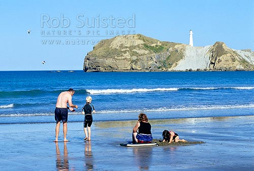 Family swimming and playing on Castlepoint Beach