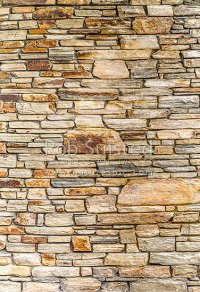 Natural schist stone wall. Schist rock layered into ...