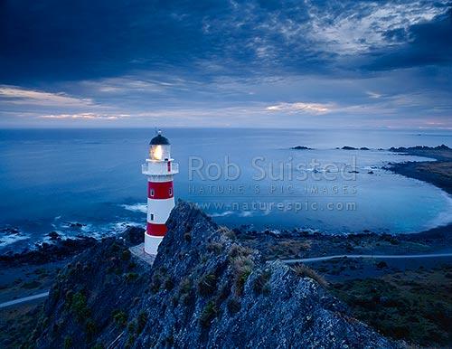 Cape Palliser Lighthouse and Palliser Bay at dusk Cape Palliser South Wairarapa District Wellington Region New Zealand NZ Stock photo from
