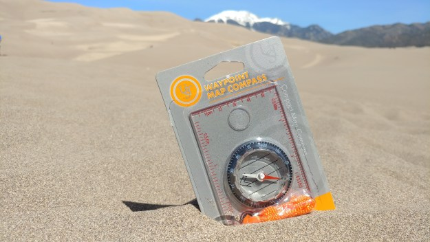 UST Compass sits in sand dune.