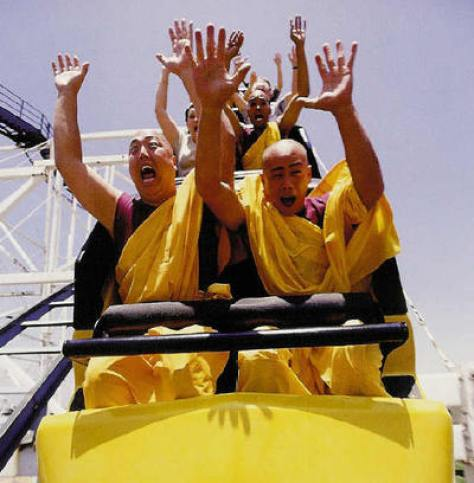 A photograph showing buddhist monks enjoying the scary thrills of a roller coaster ride. The Law of Conservation of Energy: Life's a roller coaster! - NaturPhilosophie