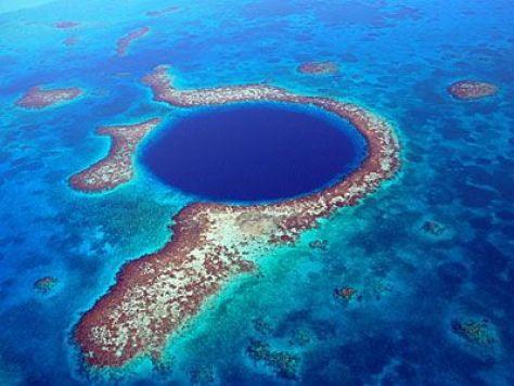 An aerial photograph of the Big Blue Hole - a stunning part of the Belize Coral Barrier Reef.