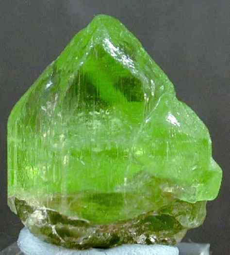 A photograph showing a block of olivine gemstone.