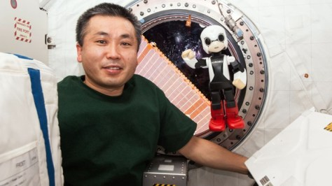 A photograph showing Japanese astronaut Koichi Wakata with the first robot astronaut Kirobo - both were recorded chatting, with Kirobo asking Santa for a rocket for Christmas, in a historic talk on board the International Space Station (ISS).