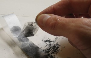 A photograph showing how to make graphene, using graphite and sticky tape.