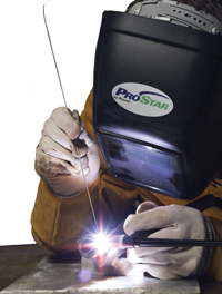 A photograph showing a heavy welder at worker. Helium Argon Shielding Gas Primer for GTAW Gas Tungsten Arc Welding.
