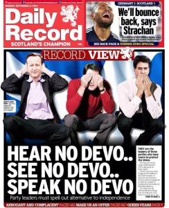 "A photograph showing the front page of the Daily Record. The caption reads: ""Hear No Devo.. See No Devo.. Speak No Devo.."""