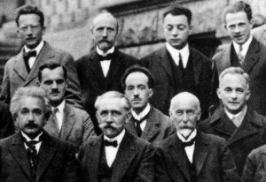 A black and white photograph taken at the Solvay Conference in 1927 - The picture shows a number of physics giants, including De Broglie and Einstein.