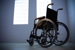 A photograph showing an empty wheelchair.