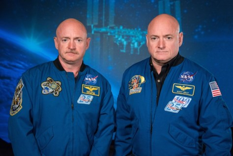 A photograph featuring twin astronauts Mark and Scott Kelly in their NASA uniform.