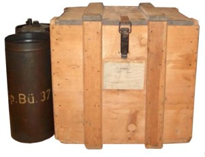 A photograph showing a canister and wooden crate full of Sprüehbüchse 37 mustard gas.