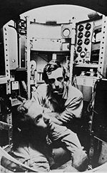 A 1960s black and white photograph of deep-sea pioneering explorers Piccard and Walsh inside the bathyscaphe Trieste.