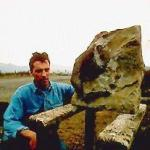 "A photograph showing Dugald Ross and ""Dougie the dinosaur"" - the sauropod femur bone discovered by Dugald on the Isle of Skye."