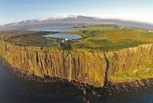 An aerial photograph showing Kilt Rock and the Mealt Waterfall on the island of Skye in northern Scotland.