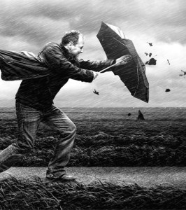 A black and white photograph showing a man struggling against the wind with his open umbrella in very windy and rainy weather conditions. Image: Adrian Sommeling